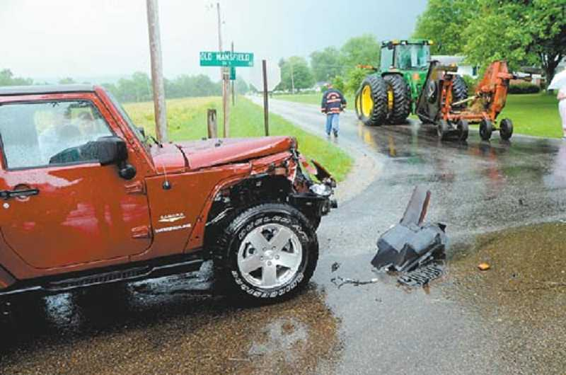 A crash caused by a speeding motor vehicle coming up behind slow moving farm equipment.