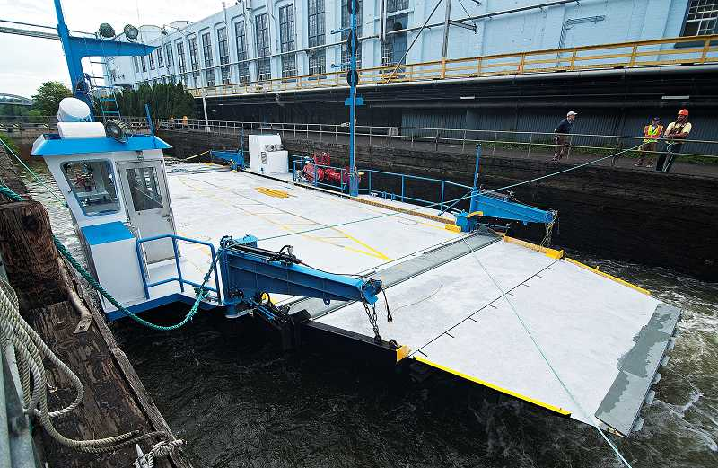 by: JOSH KULLA - The Willamette Falls Locks were temporarily re-opened July 16, allowing the newly repaired Canby Ferry to move back upstream.