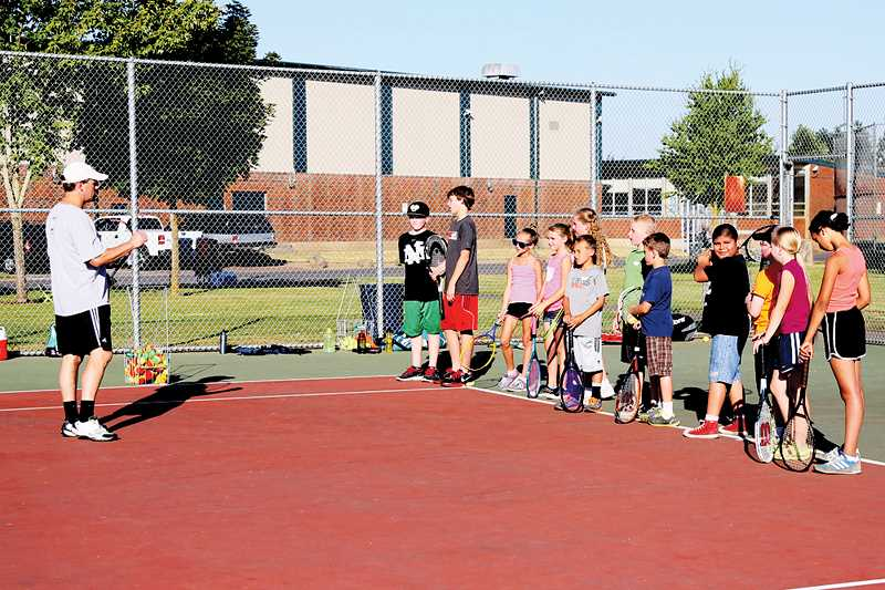 by: PHOTO BY JO WHEAT - Lance Berkey addresses a group of athletes at the North Marion Tennis Camp on Wednesday.