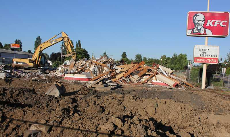 by: BY JEFF MCDONALD  - Oregon Department of Transportation crews demolished the KFC restaurant on Highway 214 last week as they prepared for the July 30 start date of the Woodburn Interchange Project.