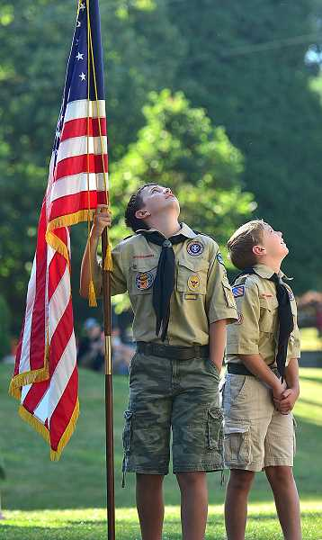 by: VERN UYETAKE - Boy Scouts await the imcoming Parachutist.