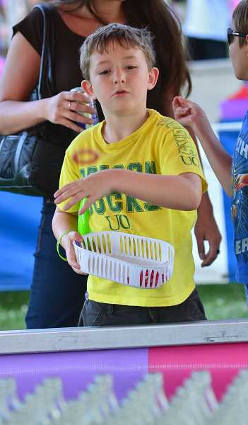 by: VERN UYETAKE - There were plenty of games at the Old Time Fair to challenge anyone.