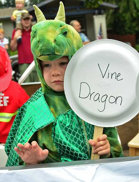 by: VERN UYETAKE - This dragon was far from frightful at the parade.
