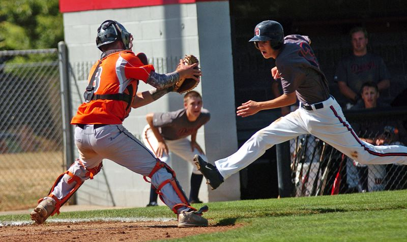 by: TIMES PHOTO: DAN BROOD - Beaverton catcher Ryan Hill is ready to tag out Tualatins Chris Fishback in the sixth inning of Tuesdays game.