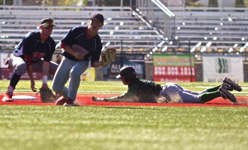 by: TIMES PHOTO: JAIME VALDEZ - Jesuit Crusaders Tommy Kaempf slides into second base against Robinson Construction in the season ending game in the OIBA tournament.