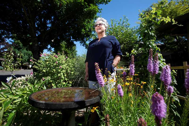 by: TIMES PHOTO: JONATHAN HOUSE - Author Janel Josephson stands in the front yard of her Aloha home. Her book, 'Images of America: Aloha-Reedville' is out now in paperback.