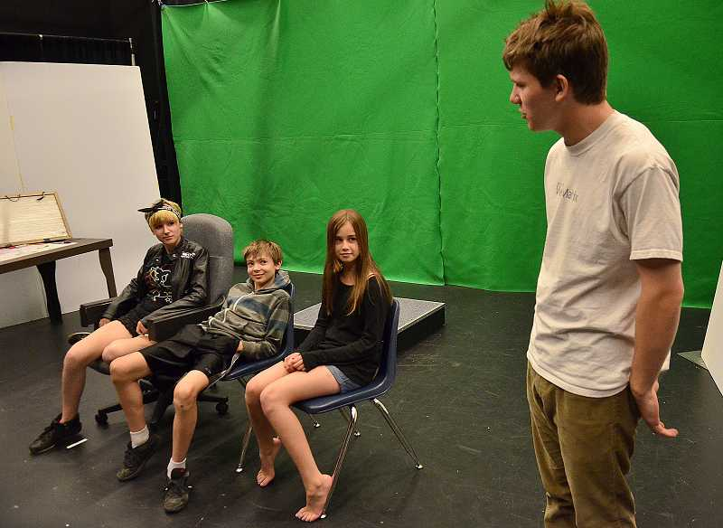 by: REVIEW PHOTO: VERN UYETAKE - Students soak up a regular dose of theater via a summer acting camp at Lake Oswego High School. Pictured are, from left, Jane McMann, Ian Ballew, Phoebe Holman and Darden Harmon.
