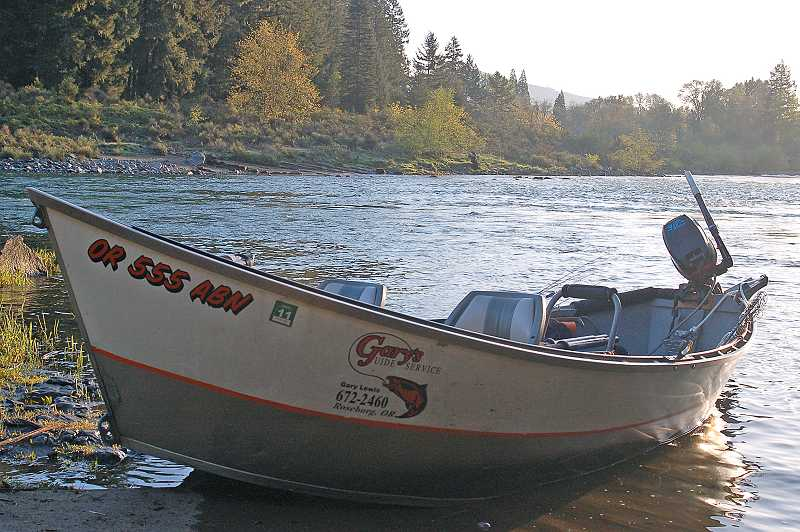 by: PHOTO BY SCOTT STAATS - One of the boats for Gary's Guide Service waits to be put to good use early in the morning on the Umpqua River.