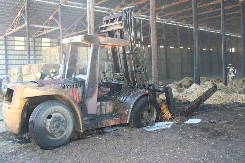 by: SUBMITTED - Fire crews averted a major barn fire Wednesday that destroyed a $30,000 Hyster at Coleman Farms in St. Paul. The fire was put out before it spread to the rest of the barn, fire district officials said.