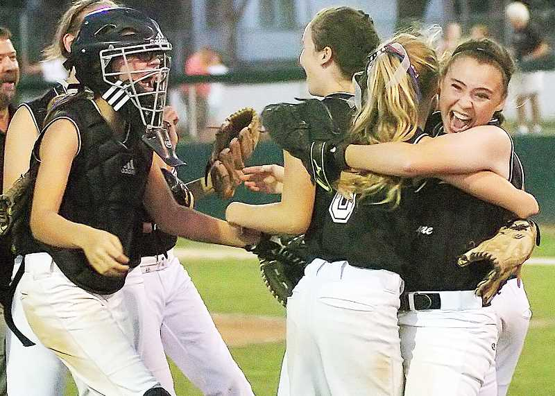 by: DAN BROOD - Jubilation - Newberg's Maddie DeVerna (far right) hugs Camille Hall after the Tualatin-Newberg major All-Stars beat SW Portland-Lincoln 11-0 on Friday to earn an automatic berth to the Little League World Series at Alpenrose Dairy in Portland next month. DeVerna, who attends Open Bible School, hit .642 for the tournament.