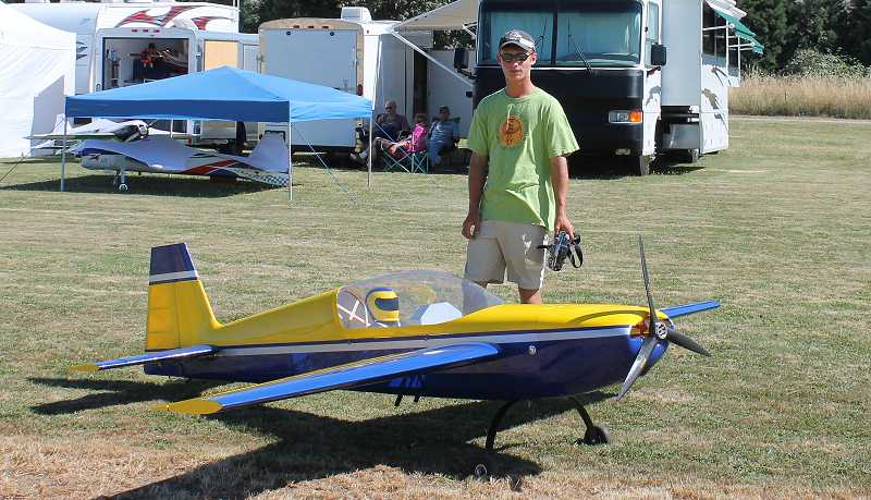 by: CORY MIMMS - John Paul Takacs, 15, and his extreme flight airframe, which he's 'going easy on,' as he's invested about $5,000 into it. Takacs has been flying gas planes for two years and competing for one.