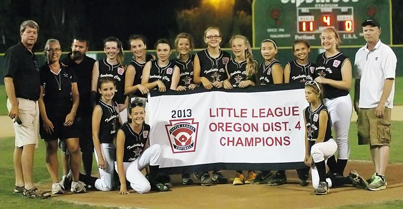 by: DAN BROOD - THE CHAMPS -- The Tualatin City Little League Majors all-star team players and coaches gather with the District 4 championship banner following their 11-0 win over Southwest Portland Little League.