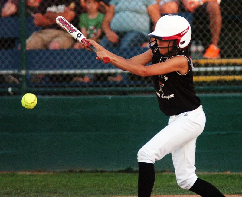 by: DAN BROOD - FUNDAMENTALS -- Tualatin City's Kendra Zuckerman puts down a bunt in the Distric 4 championship game.