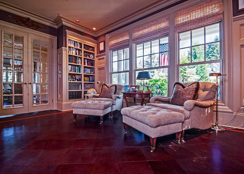by: JOSH KULLA - The leather floor of the study in this Wilsonville home adds a warmth and sophistication to the room.