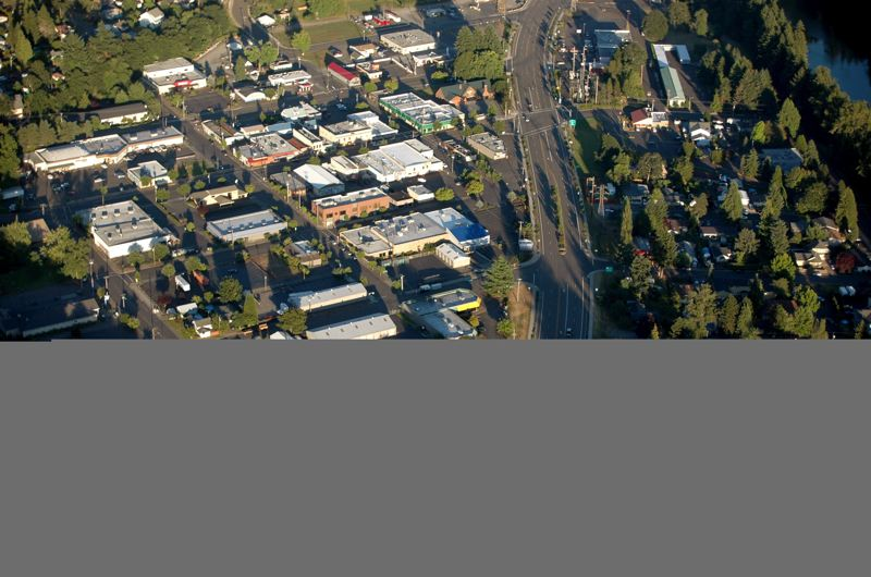 by: ISABEL GAUTSCHI - Estacada from the sky. Rhodes flew Beguelin over his house and high school.