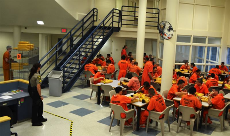 by: COURTESY OF WASHINGTON COUNTY SHERIFFS OFFICE - Inmates crowd in for a meal in one of the sections of the Washington County Jail that opened in 1998.