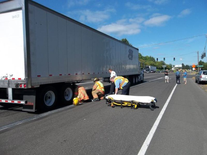 by: PHOTO COURTESY: OSP - Pictured is the scene along Highway 224 in Clackamas where a semi-truck almost ran over an elderly man on Saturday morning.