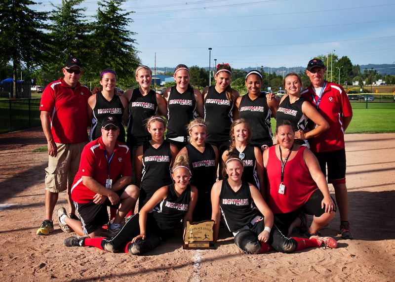 by: SUBMITTED PHOTO - Oregon City Nightmare players and coaches pose proudly with their third-place hardware from the recent Oregon ASA 14-B State Fastpitch Softball Championship Tournament. Pictured are: (front, from left) Amanda Manning and Katie Moon; (first row) Coach Jeff Moon, Marci Roberti, Ava Van Duzer, Megan White and coach Christina McLeod; and (back) coach Scott Manning, Zoee Haines, Megan Blackman, Jadwyn Parrish, Shianne Smith, McKinzie McLeod, Sierra Lehman and head coach Chris Parrish.