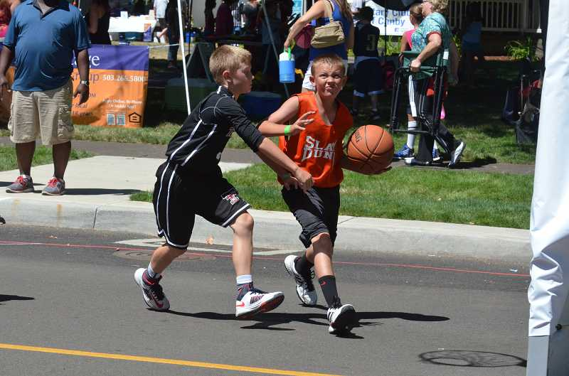 by: JEFF GOODMAN - Close to 400 players participated in 15 different age brackets during the 14th-annual Nothing But Net charity basketball tournament July 27 at Wait Park in Canby.