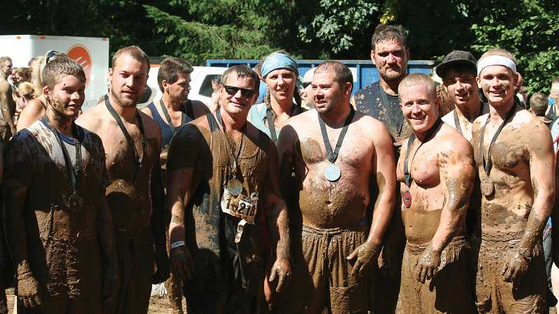 by: COURTESY OF SHELDON SANDERS - A few of Molalla's residents who participated in Warrior Dash last year. From left to right: Darren Early, Grant Koutny, Brad Stone, Sheldon Sanders, Jill Lantz, Jay West, Ken Alley, Eric Stafford, Zach Stonehocker and Jake Moore.