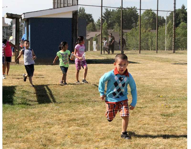 by: LINDSAY KEEFER - Students in the Woodburn School District After School Club-sponsored migrant summer program represent just a small fraction of students who will benefit from a new 21st century grant funding after school programming. Students this year, including kindergartner Edwin Sandoval Torres, took part in a fun run around the Woodburn High School fields.