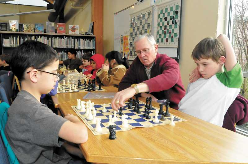 by: SUBMITTED PHOTO: PORTLAND REIGN PHOTOGRAPHY - Rotarian Jack Kohl helps teach chess to students at Boones Ferry Primary School in December 2012.