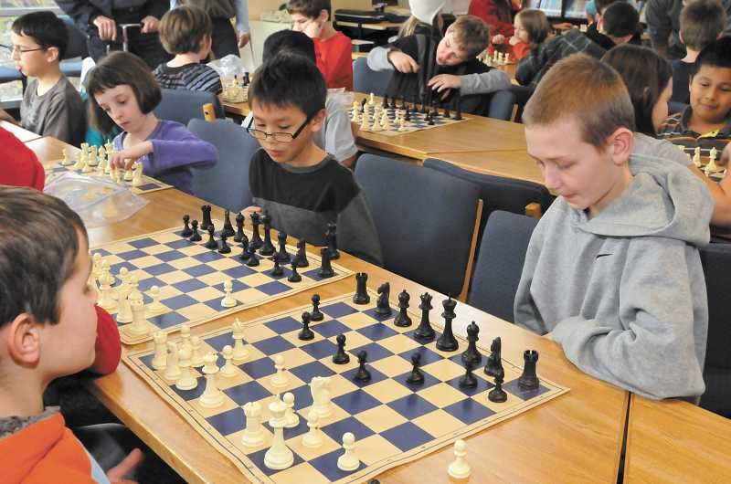by: SUBMITTED PHOTO: PORTLAND REIGN PHOTOGRAPHY - More than 30 students at Boones Ferry Primary School have participated in Chess for Success for the past two years.