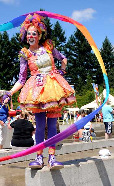 by: JOSH KULLA - Fun in the Park is exemplified by Cha Cha the clown and other roving revelers who transform Town Center Park into a playground for all ages each year.