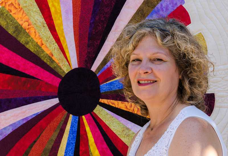 by: RAY HUGHEY - Aurora's Debbie Scroggy will show off her custom quilt entitled 'Starburst' at the Pacific West Quilt Show in Tacoma, Wash., in late August.