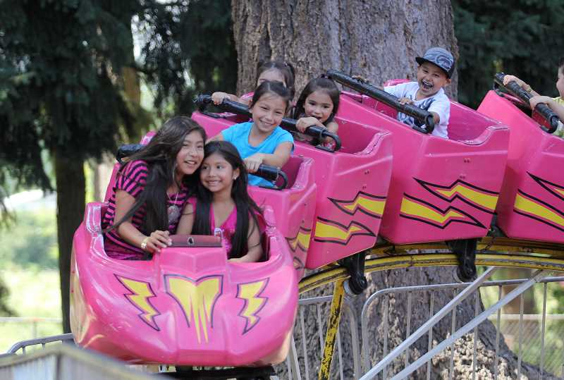 by: INDEPENDENT FILE PHOTO - Children enjoy the carnival rides at the Fiesta Mexicana 2012. Carnival rides will return to Legion Park along with Fiesta this Friday through Saturday.