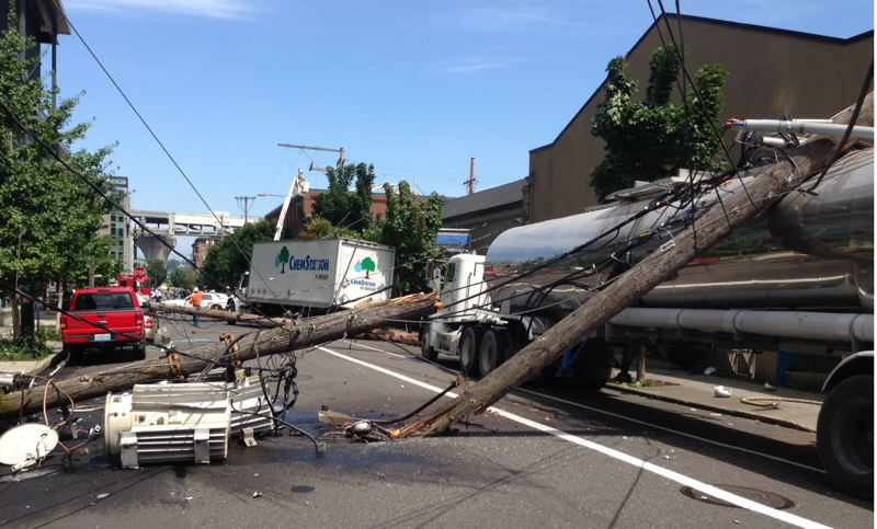 by: COURTESY OF PORTLAND POLICE BUREAU - A truck accident on Northwest 14th Avenue near Marshall Street damaged several power lines and brought down a transformer and utility poles.