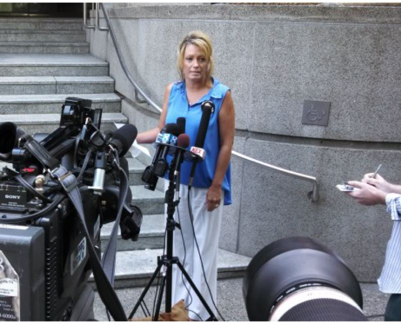 by: KOIN LOCAL 6 - Desiree Young answers reporters' questions outside the Justice Center in Portland on Tuesday.