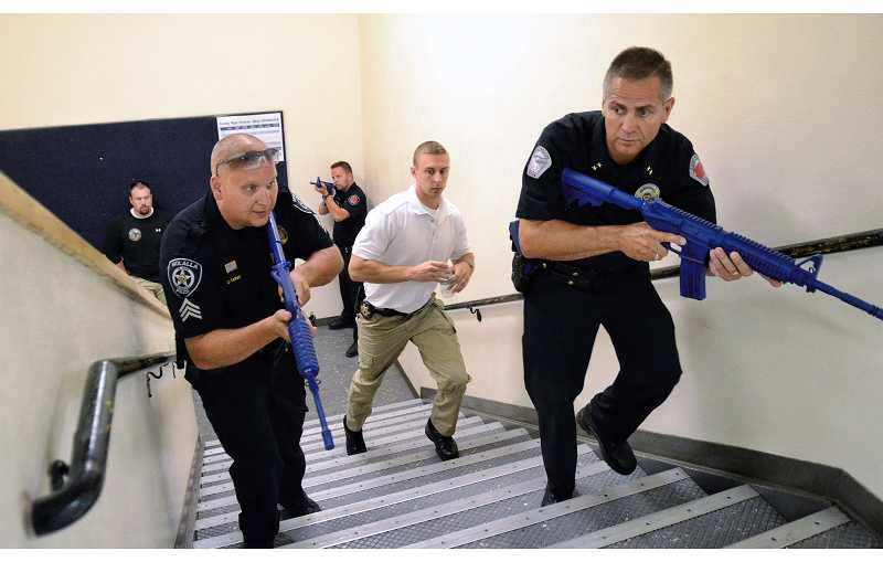 by: RAY HUGHEY - More than 165 police officers underwent specialized training at Canby High School recently, simulating an assault on a school building.