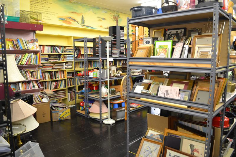 by: CONTRIBUTED PHOTO:  - Some of the shelves in the Sandy Community Action Center thrift store looked pretty disorganized before the renovation.