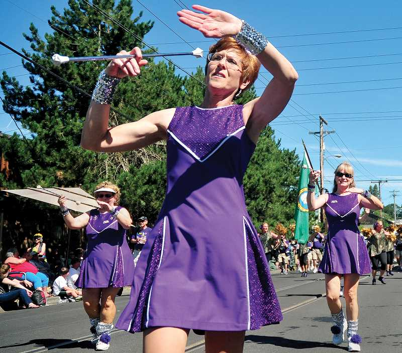 by: GARY ALLEN - Members of The Beat Goes On Marching Band of Portland entertained parade-goers Saturday morning.