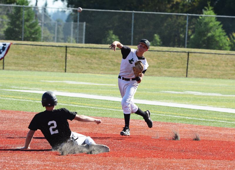 by: TIMES PHOTO: MATT SINGLEDECKER - Jesuits Donovan Baldocchi tries to turn a double play in the second inning against Sherwood.