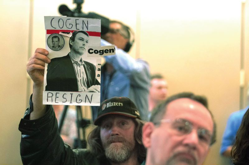 by: TRIBUNE PHOTO: JONATHAN HOUSE - A man who identified himself as Lightning holds a sign demanding Multnomah County Chair Jeff Cogen resign during public testimony on a no-confidence resolution last week.