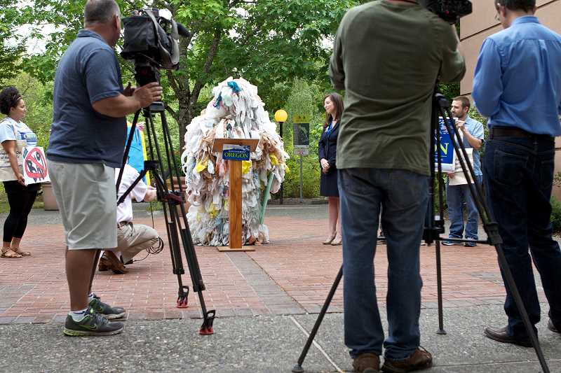 by: TIMES PHOTO: JAIME VALDEZ - The 'Bag Monster' makes a statement during a press conference outside Tigard City Hall on Tuesday. Environment Oregon has been gathering signatures for weeks for a possible ban on plastic bags in Tigard, Lake Oswego and Beaverton.