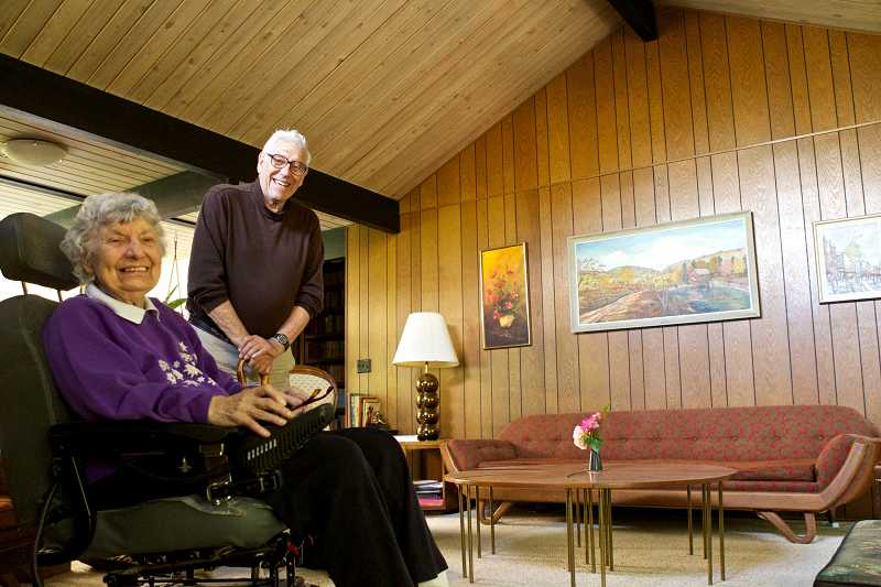 by: TIMES PHOTO: JAIME VALDEZ - Paul and Polly Herman, pictured in their living room, were the first to build a Rummer-designed home in Garden Home.