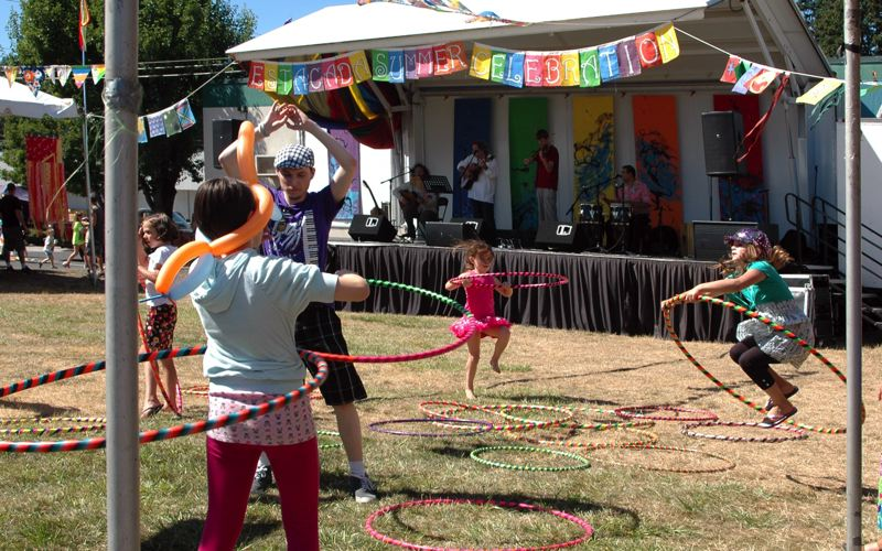 by: ISABEL GAUTSCHI - This years Summer Celebration had a lot of madcap fun. Kids enjoyed hula hoops while the Latin American folk band Grupo Condor played.