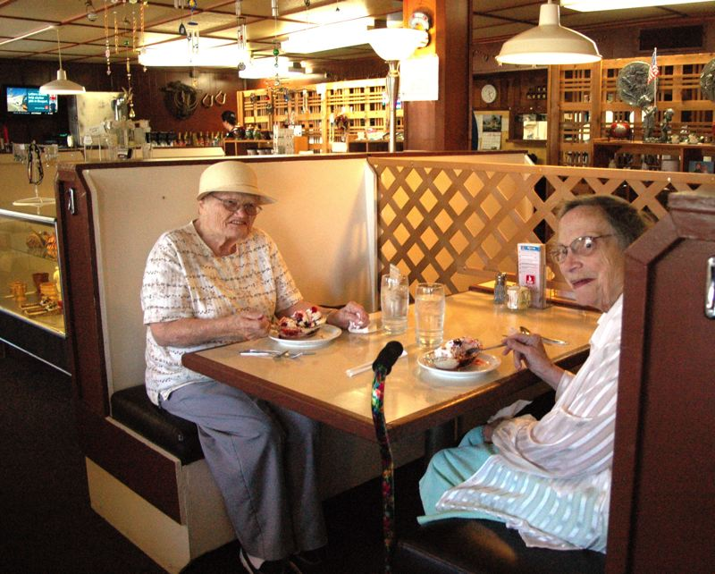 by: ISABEL GAUTSCHI - Former employees Betty Strode and Deloris Bethea enjoy an afternoon sundae. Strode worked for the restaurant for 17 years, Bethea worked there 12 years.