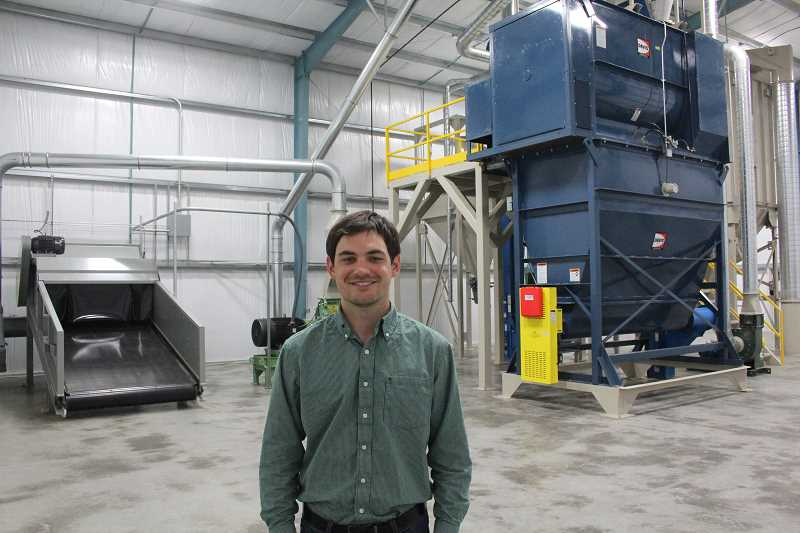 by: JEFF MCDONALD  - Blake Crosby, sales, marketing and operations manager at Crosby Hop Farm LLC north of Woodburn, says the new pellet mill will allow his familys farm to sell direct to craft brewers.