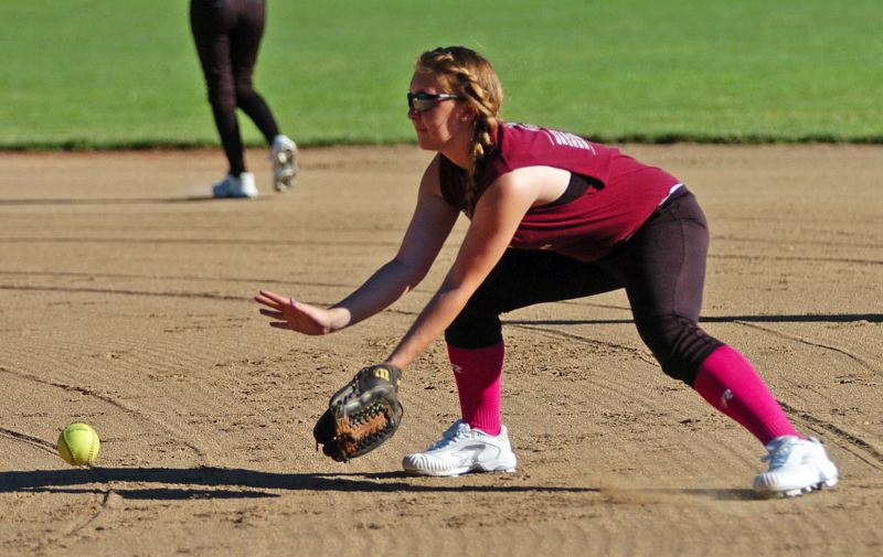 by: DAN BROOD - PRACTICE MAKES PERFECT -- Tualatin City's Noelle Sawyer gets ready to field a grounder during the team's practice session held last week at Tualatin Community Park.
