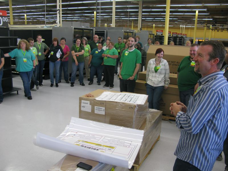 by: PHOTO BY: RAYMOND RENDLEMAN - Oak Grove Walmart store manager Troy Steele (far right) gets his employees fired up to prepare the 63,000 square feet for a grand opening next week.
