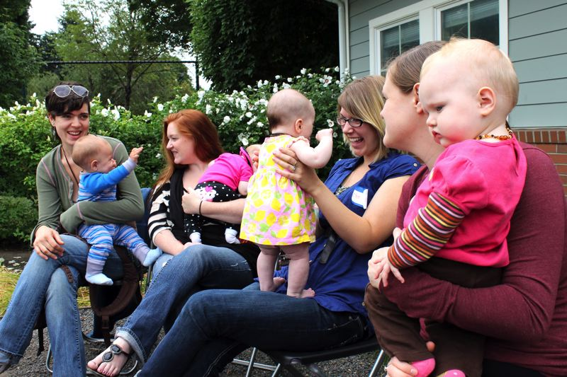 by: OUTLOOK PHOTO: CARI HACHMANN - Thirteen mothers and babies along with other family members and activists, gathered Friday, Aug. 2 for Greshams first Big Latch On. The mothers simultaneously breastfed their babies for one minute.