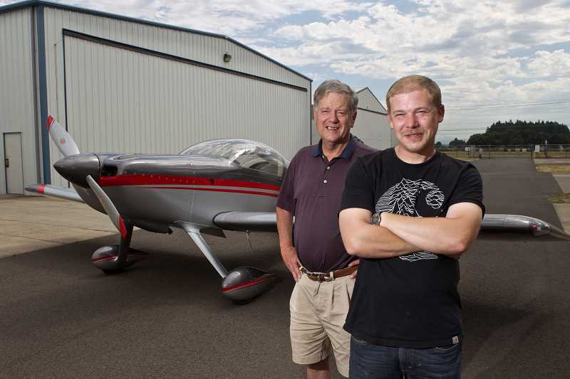 by: JAIME VALDEZ - David Charno and Jon Charno proudly pose in front of their grand champion aircraft.