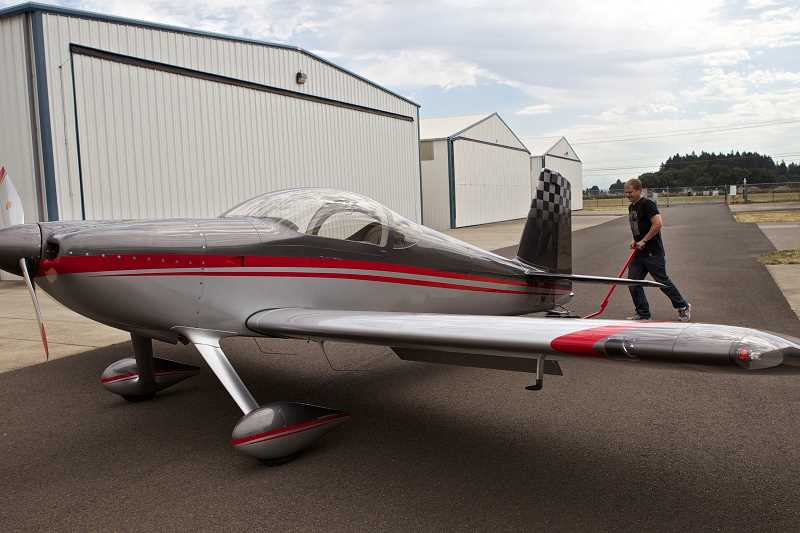 by: JAIME VALDEZ - Jon Charno takes the RV-7 plane he built out of the Aurora airport hangar.