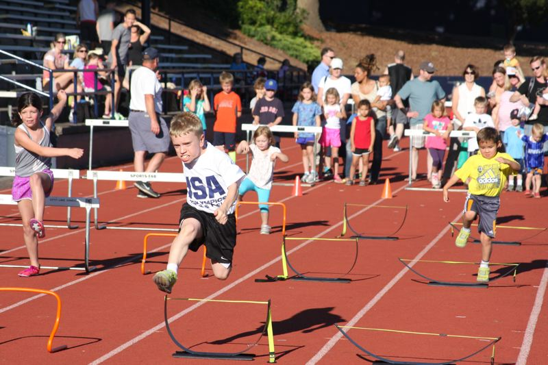 by: SUBMITTED PHOTO - Adin Williams competes at Lake Oswego High School/Foot Traffic all comers meet last month to train for the World Dwarf Games.