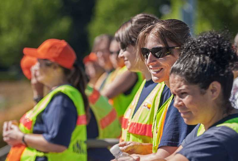 by: JOSH KULLA - Coffee Creek Correctional Facility inmate Shannon Thompson (in sunglasses) hadnt been outside prison walls in 11 years before July 26, when she joined 16 other inmates to set up the Wilsonville Kiwanis Kids Fun Run.