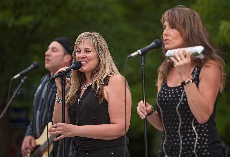 by: JOSH KULLA - Vocalists Becky Pershing (left) and Michelle Kuepker perform on Aug. 1 at Town Center Park as part of Global FM and the Wilsonville Rotary Summer Concert Series.